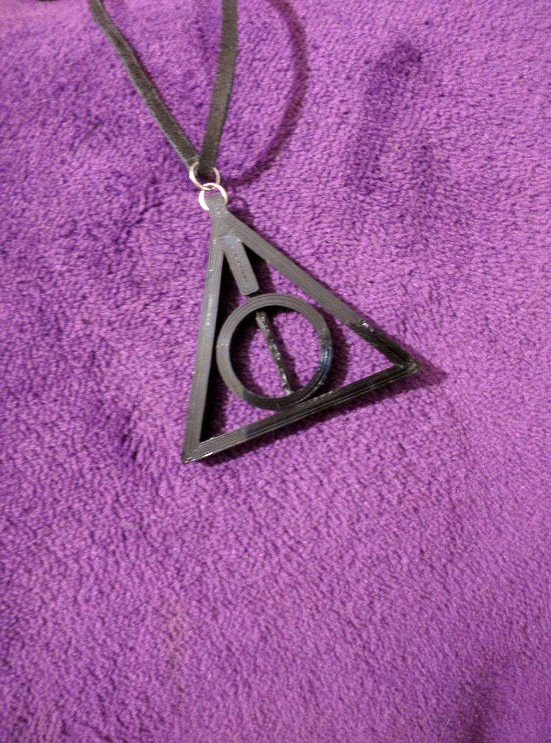 Harry Potter Deathly Hallows with Spinning Ring on Suede Leather Cord by KudzuCatCreations on Etsy