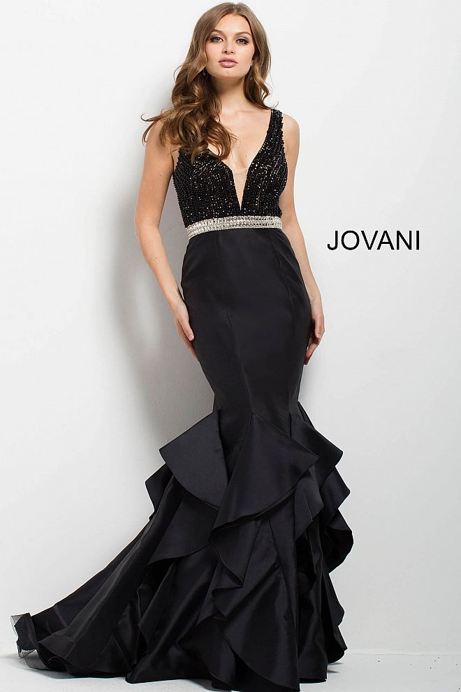 fa4b069e36 ... buy online 55f86 7a53e Floor length form fitting black evening gown  with tiered mermaid bottom features ...