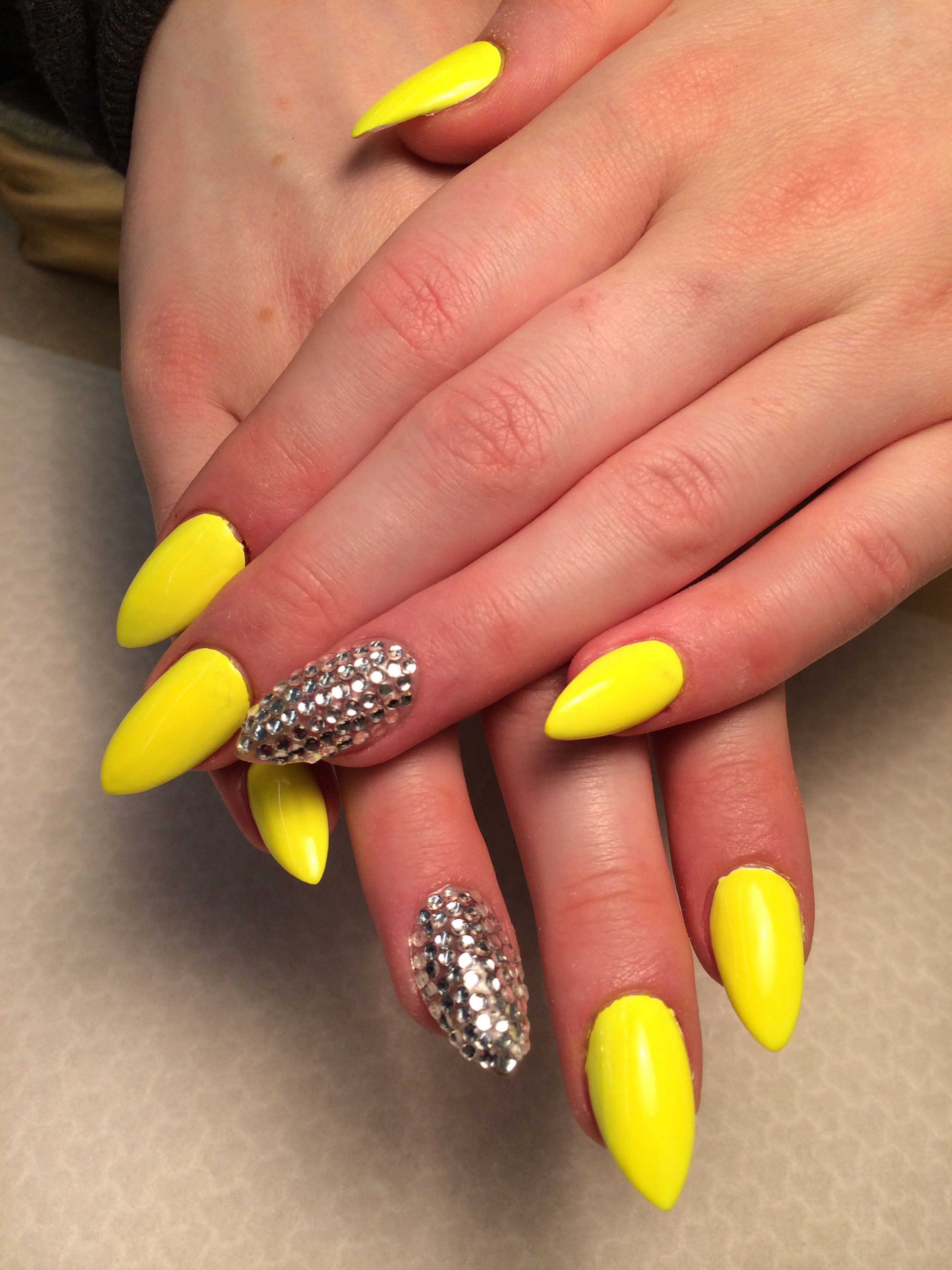Stiletto bright yellow nails and one finger bedazzled with diamond ...