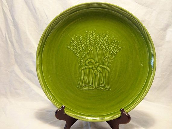 """Gorgeous grassy green color on this 50s vintage Franciscan Winter Green Wheat pattern dinner plate, manufactured between 1951-1954. Perfect condition.  Measures 10.5"""" wide."""