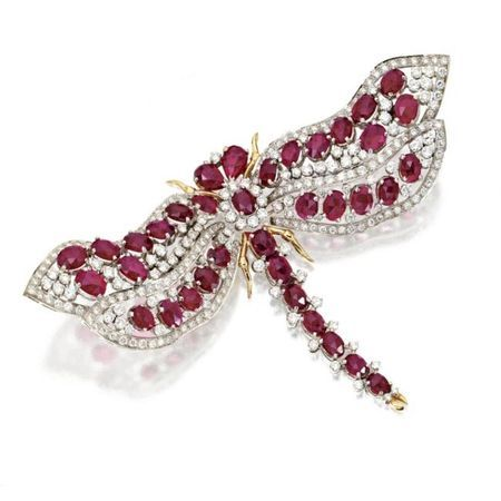 Ruby and diamond dragonfly brooch during-, Trio. photo courtesy Sotheby's Set with round diamonds Weighing Approximately 7.35 carats, additionally set with oval and pear-shaped rose-cut rubies, mounted in 18 karat white and yellow gold, signed Trio.