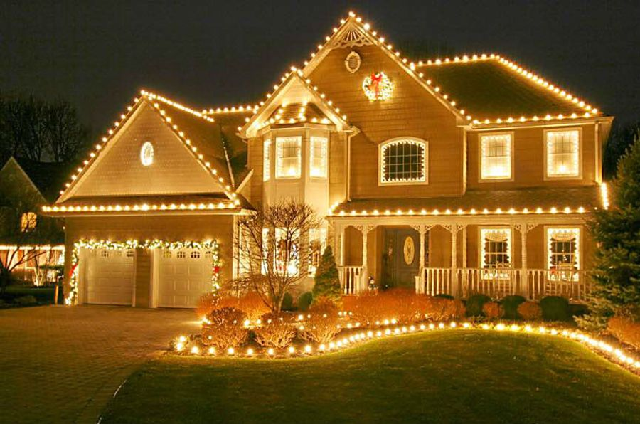 some landscaping companies are brightening up their ledgers in the off season by hanging christmas lights for homeowners
