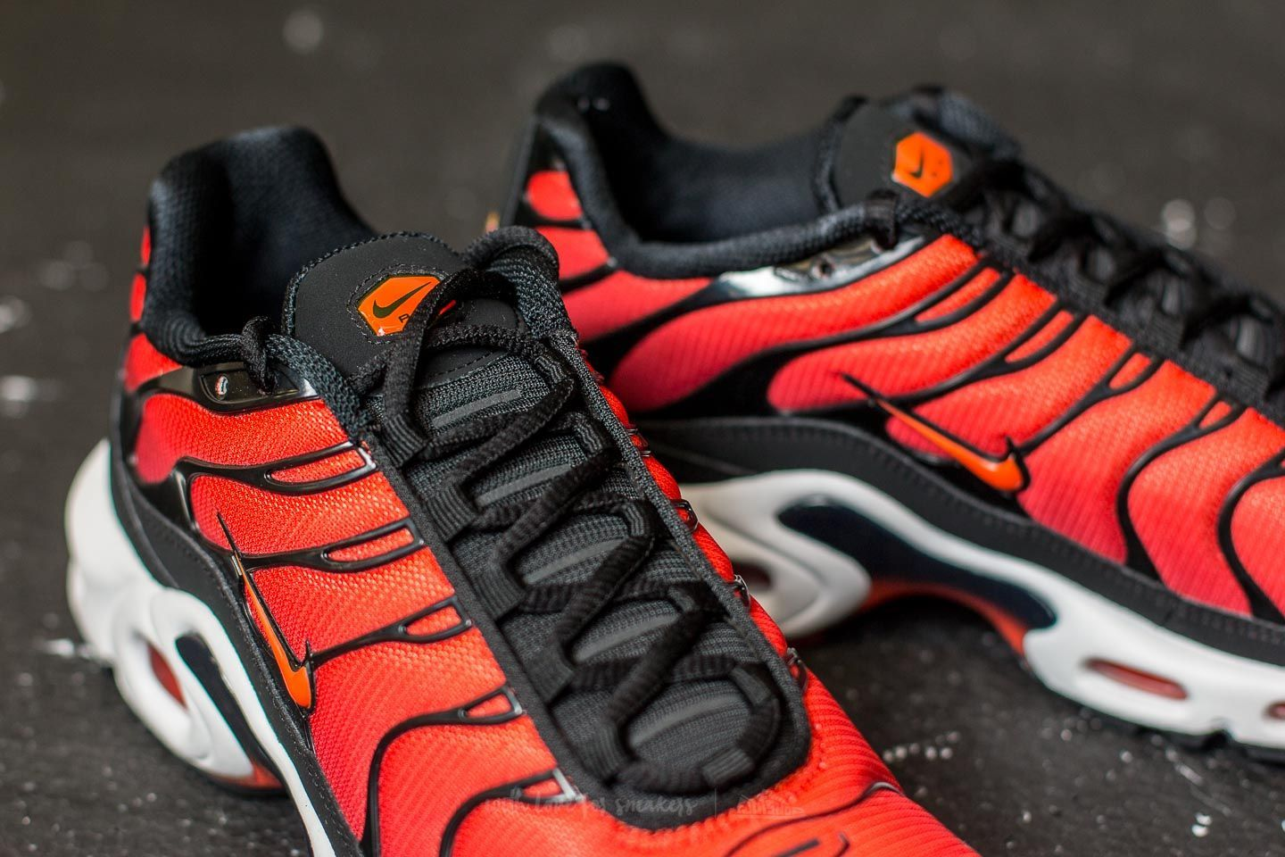5c913da26b2d The Nike Air Max Plus is featured in a new Team Red colorway for this Fall