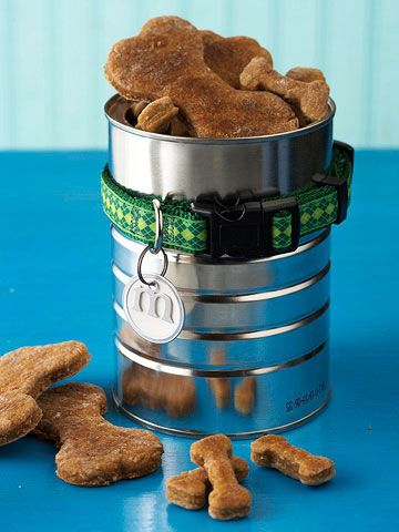 An empty coffee can and a small dog collar create a clever canister for delivering treats to your favorite pooch.    1. Slide a metal scrapbooking letter onto the ring of a paper key tag. Attach the tag to a small dog collar.    2 Place the dog collar around the outside of a small coffee can. See the next slide for a materials list.