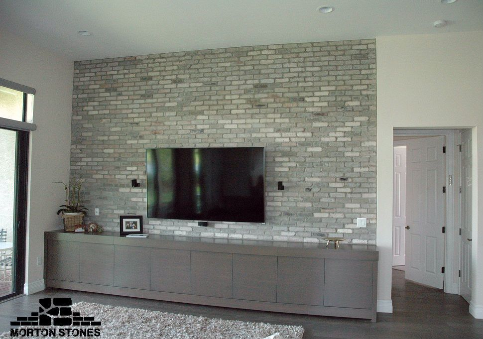 Example Of A Modern Living Room Decorated With Gray Brick Tiles