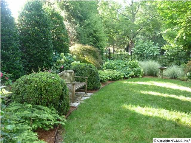 Love the placement of the outdoor bench with stones underneath.