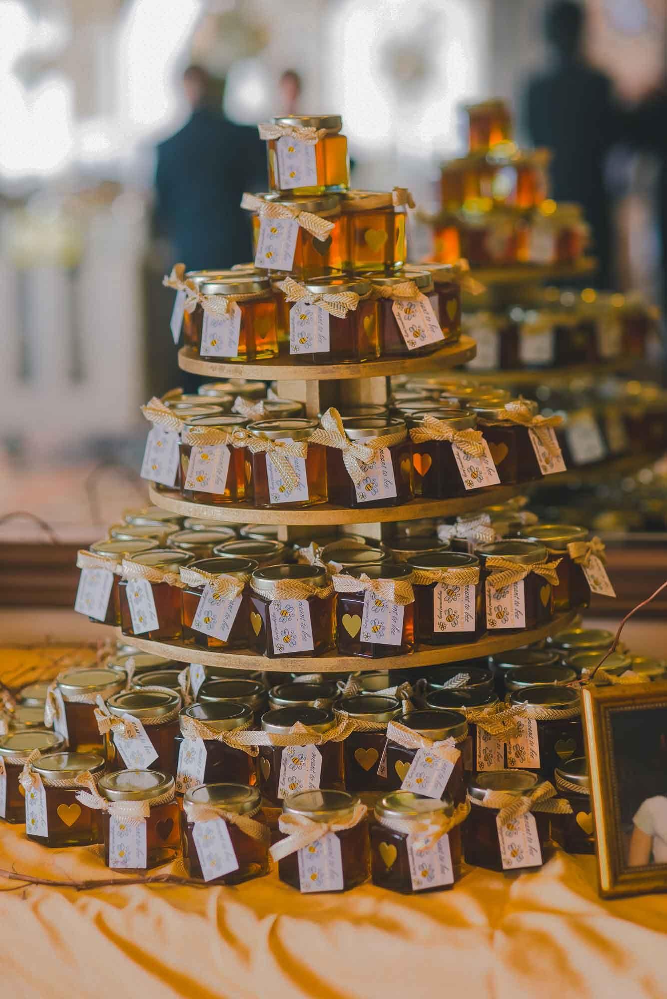 6oz honey wedding favors piled high in a terrific favor