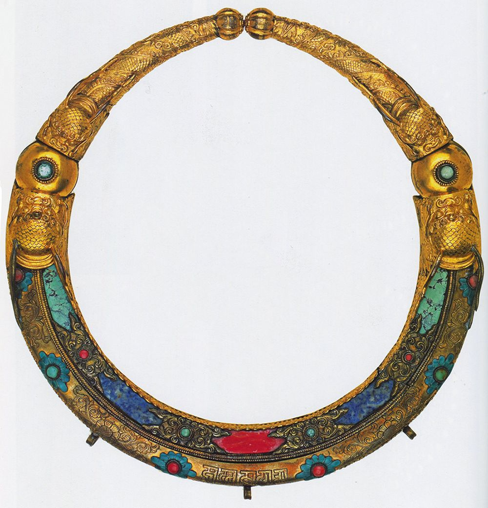 Ceremonial Necklace, copper-gilt, lapis lazuli, turquoise, coral and blue enamel. 18th or 19th century. Kathmandu Valley, Nepal. A collar worn by both boys and girls in childhood initiation rituals.