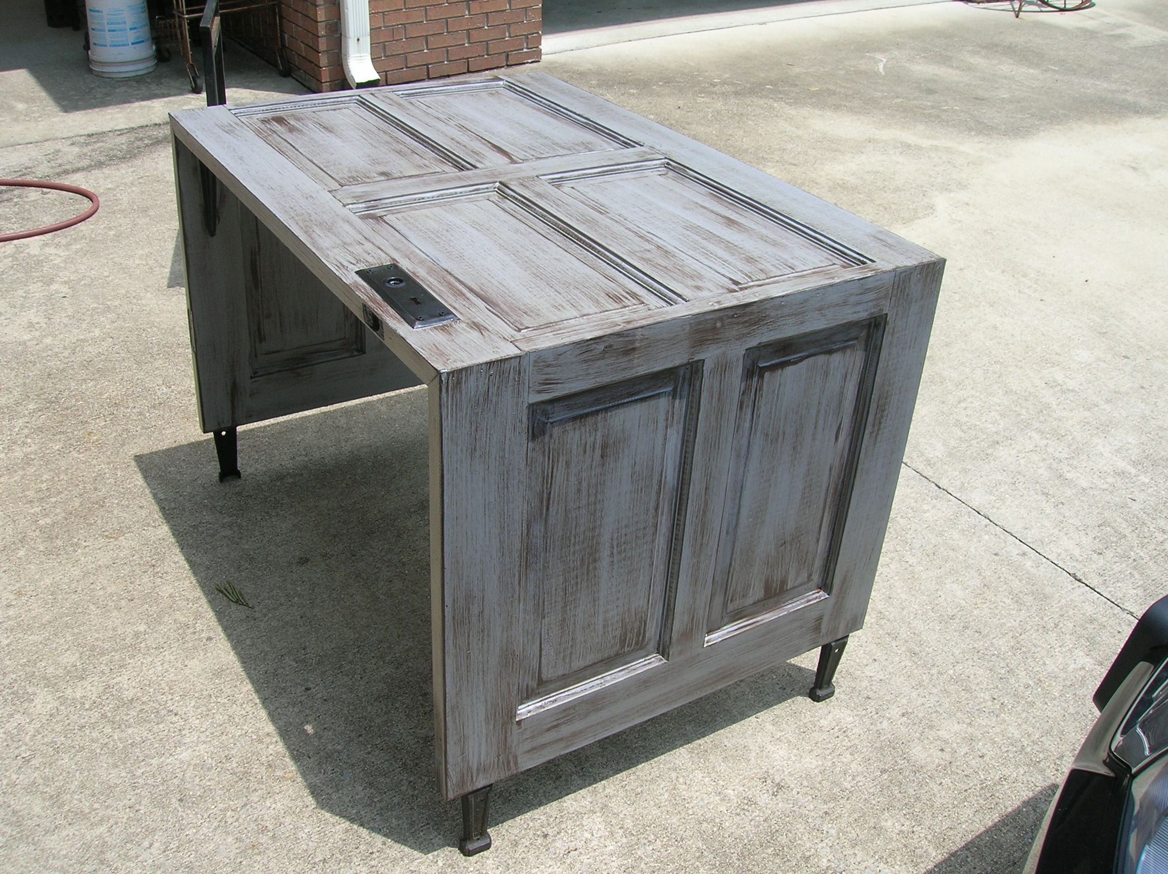 This Is A Desk Or Table Made From Old Door With Bath Tub Legs.