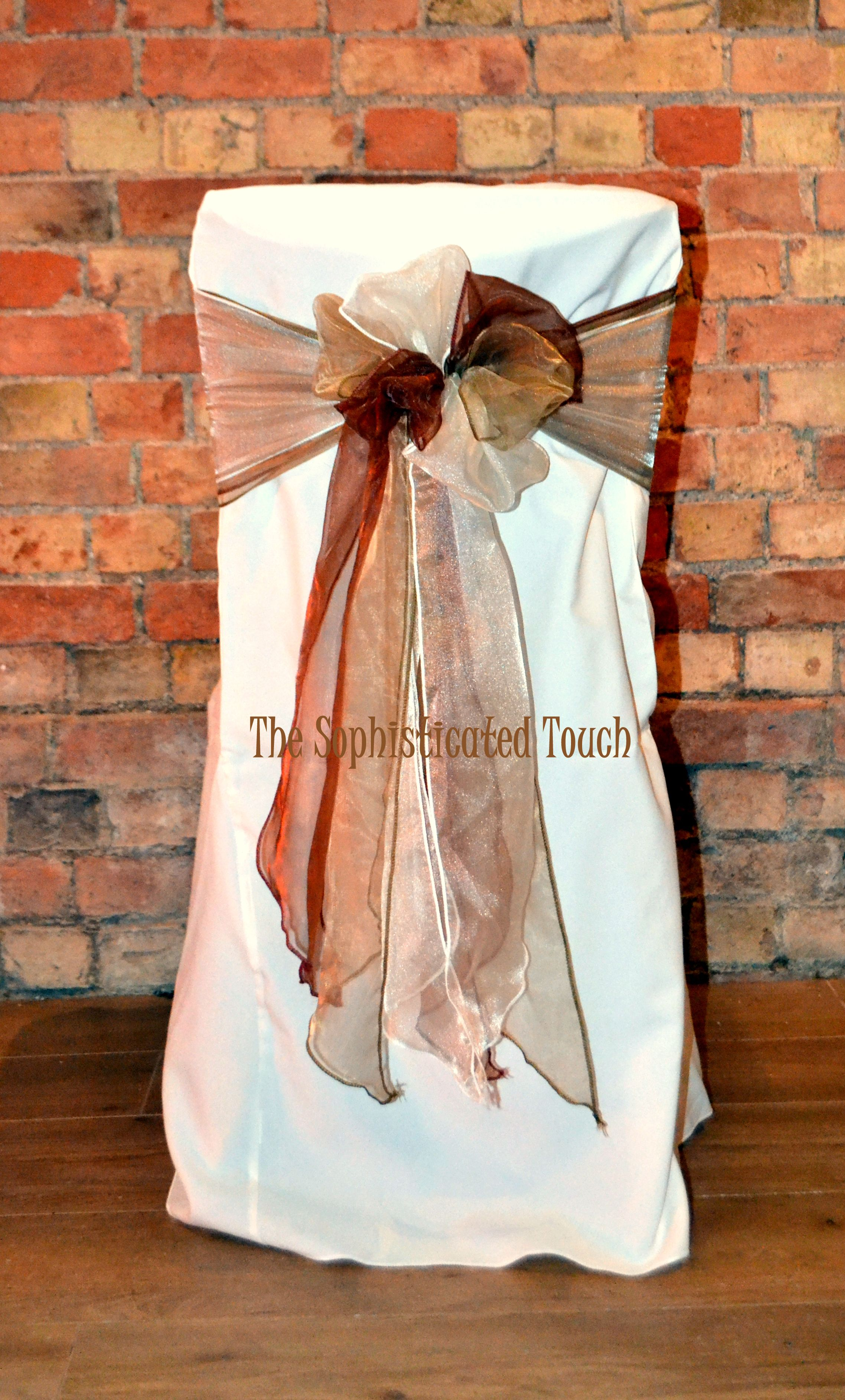 5f82dabaed2f1d Triple Bow of Chocolate Gold and Ivory Organza on an Ivory Chair Cover