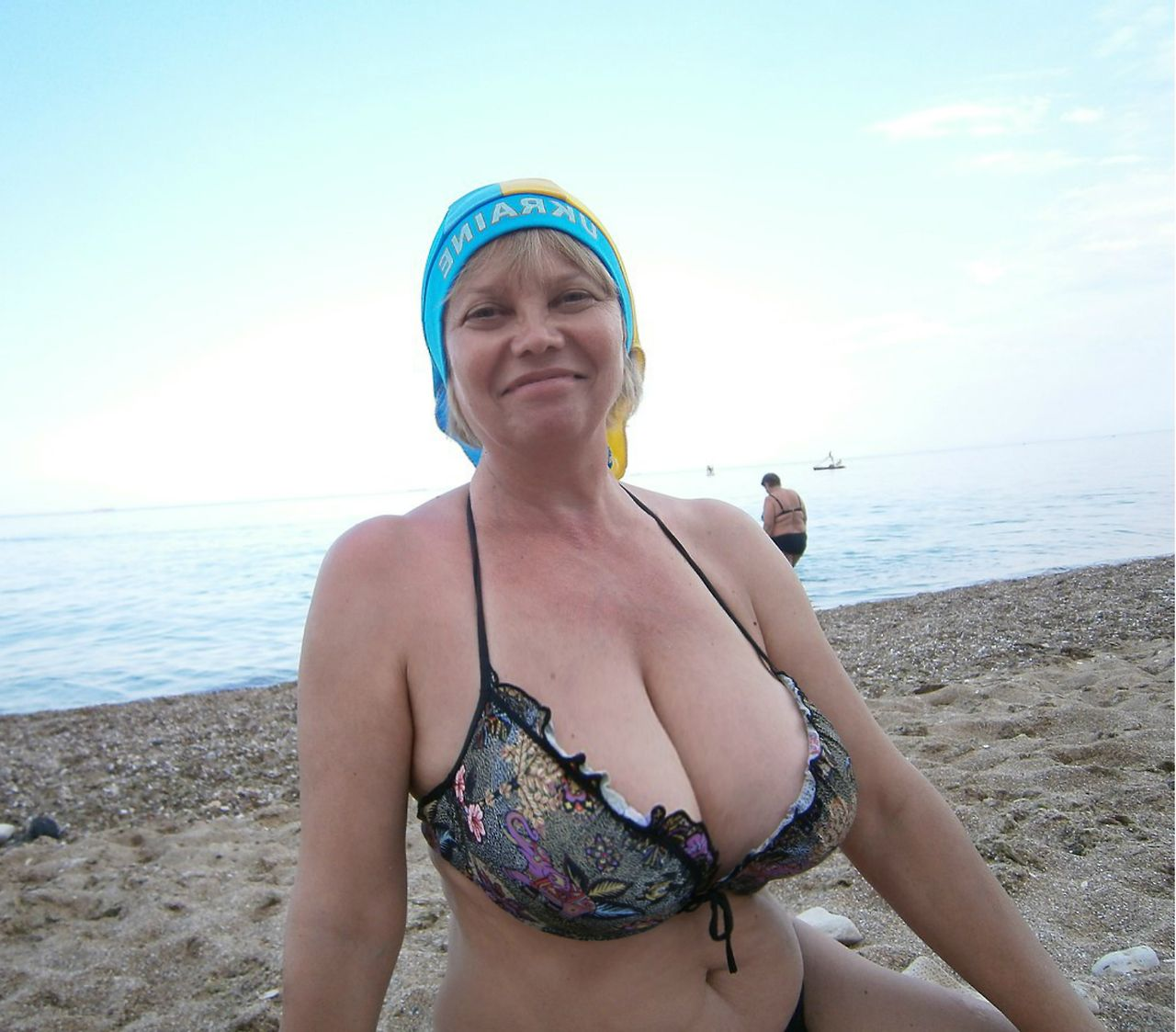Busty milf on beach