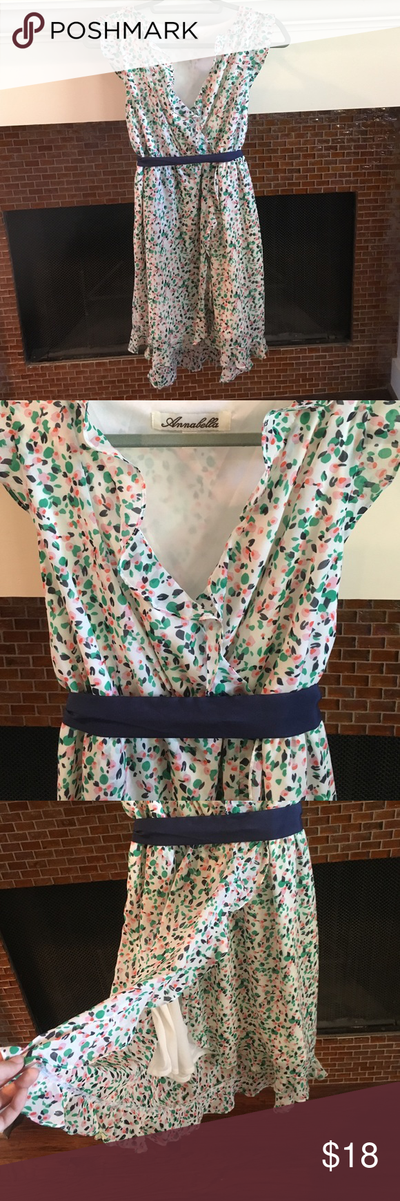 Floral dress! Perfect sumner dress with pink, green, & navy flowers. The navy tie can be tied in the front or back depending on your preference! Annabella Dresses