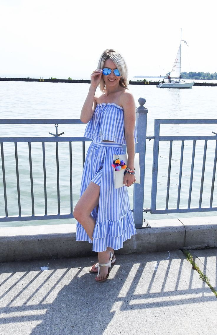 d5831fc939 Gorgeous summer beach outfit, striped two piece skirt and ruffle top, pom  pom clutch, rayban aviators, tassel bracelets, tiaras and heels blog, ...