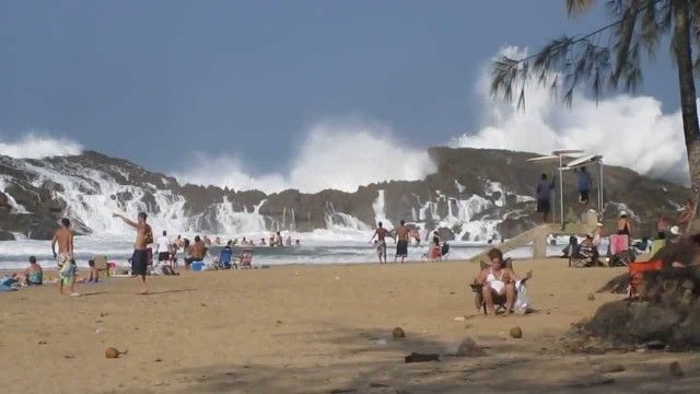 Watch this massive wave pound the rocks of this enclosed beach