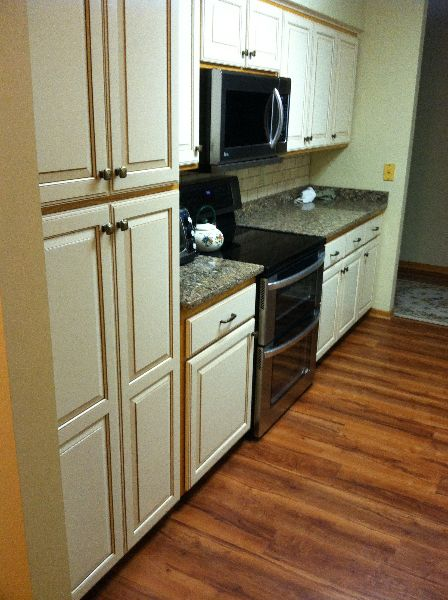 New painted doors and drawer fronts update oak cabinets ...