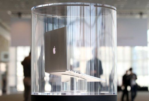 The new MacBook Pro is displayed in a case at the Apple 2012 World Wide Developers Conference (WWDC)