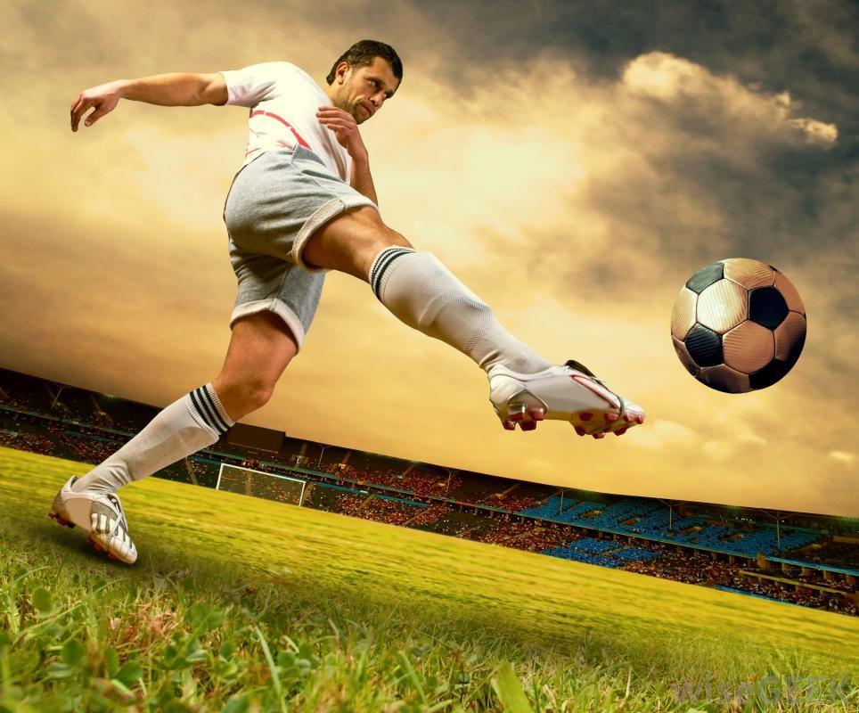 A soccer player kicking a ball. European soccer, Soccer