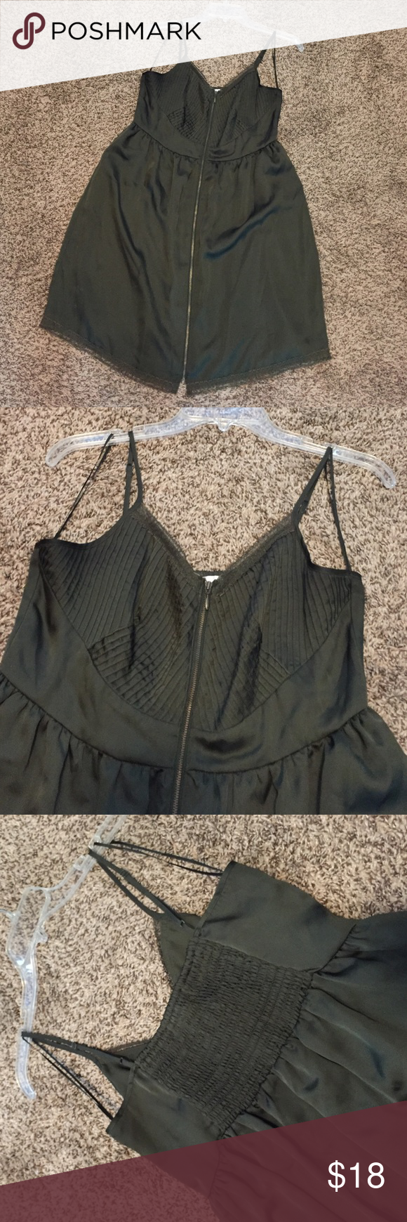 LC Lauren Conrad green slip dress Lauren Conrad olive green slip dress with lace trim and stretchy back. Zips all the way down the front. Fully lined, adjustable spaghetti strap. Size 10, fits TTS! LC Lauren Conrad Dresses Midi
