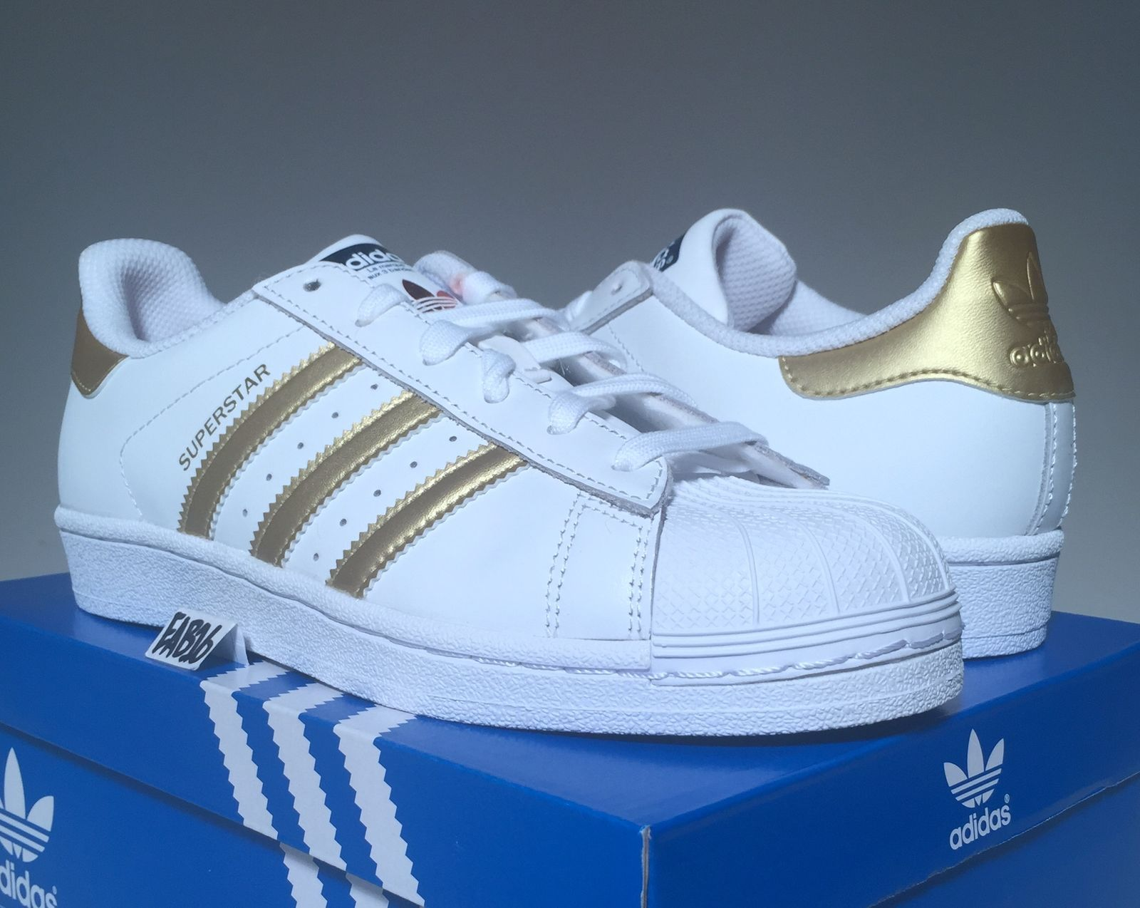 adidas superstars black white and gold junior