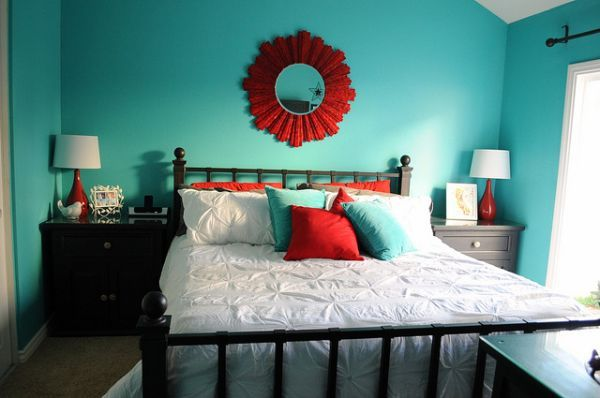 Turquoise bedroom with red and turquoise throw pillows for accent
