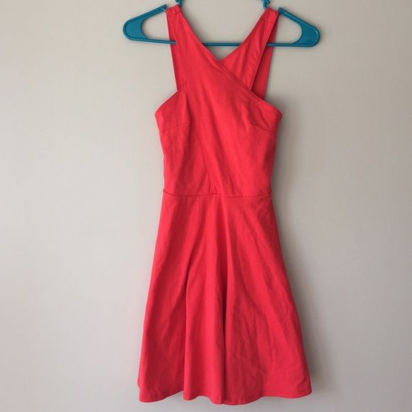 NWOT Flirty Hollister Coral sun dress I bought this with the hope of wearing it on a California trip but I'll be too busy and want it to find a home where it can be enjoyed 😭 it's so stinkin cute! No imperfections. Wearing a bra with this, I've yet to figure out how without it showing 😅 oh and it's mid thigh length Hollister Dresses Midi
