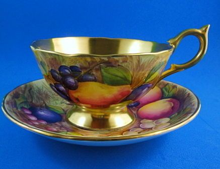 Rich Gold Signed D.Jones Fruit Painted Aynsley Aynsley Tea Cup and Saucer Set