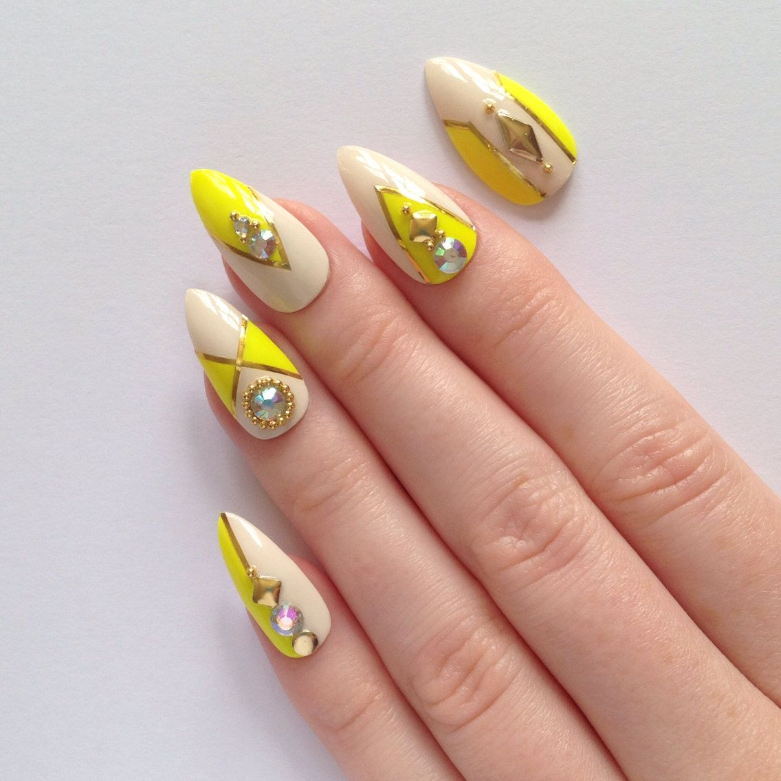 Neon yellow stiletto nails Nail designs Nail by prettylittlepolish ...
