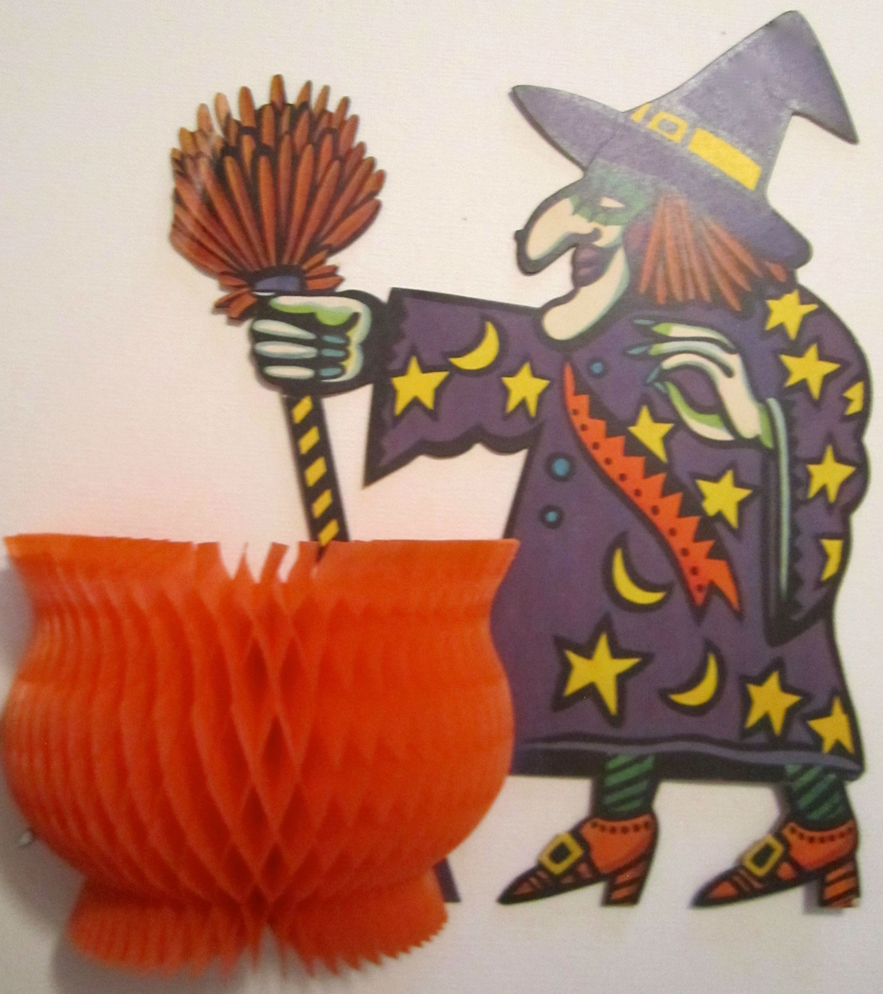 I think she is a vintage Dennison Witch and honeycomb cauldron from the early 1970's