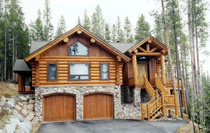 Log Home With Stone Work.
