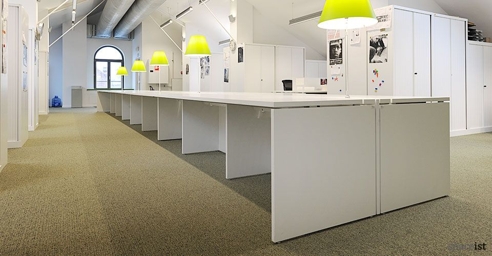 Extra Long Modular White Bench Desk With White Slab Ends.