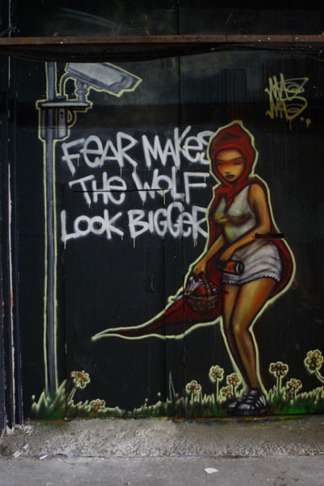 """Fear makes the wolf look bigger."" Red Riding Hood graffiti."