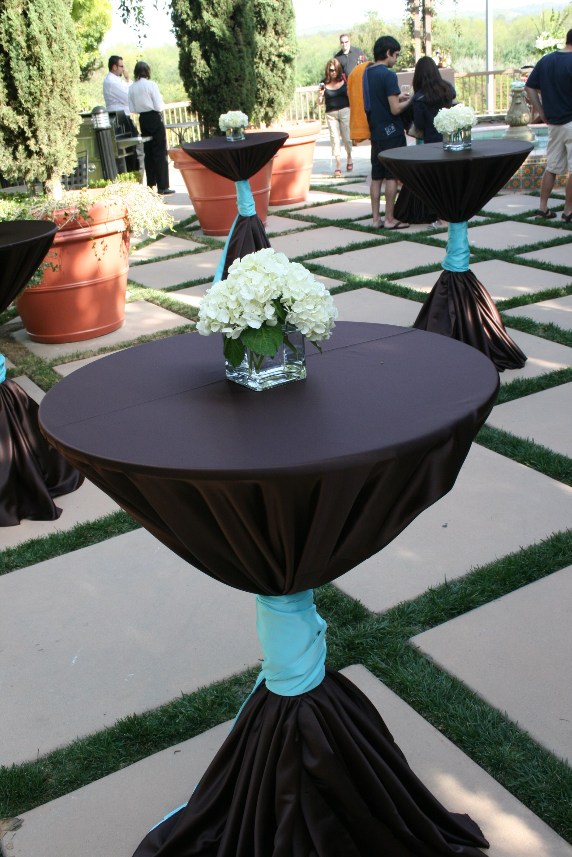 Tall Cocktail Tables With Chocolate Satin Table Cloths And Turquoise Satin  Sashes Tied In The Middle