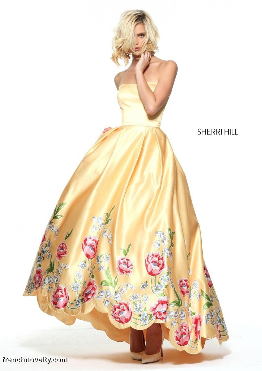 ff078fcd0375 Sherri Hill 51139 is a strapless prom dress with a full skirt with a floral  bordered, scalloped hem.