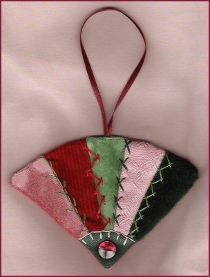 Victoriana Dresdens - Crazy Quilted Fan Ornament. Free to Members Pattern available exclusively online here: http://www.victorianaquiltdesigns.com/VictorianaQuilters/PatternPage/VictorianaDresdens/FanOrnament.htm #quilting #Dresdens #Fan #Ornament