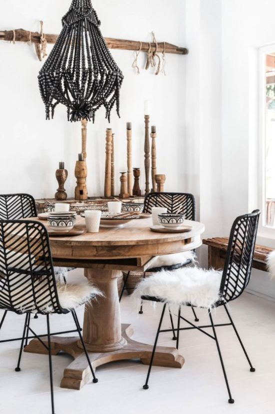 Boho Dining Space With A Bead Chandelier And Rattan And Wooden