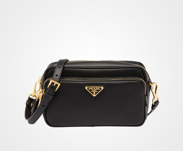 cd685180264b10 Prada Saffiano double zipper mini camera bag with padlock. Something about  the enamel triangle will always be classy.