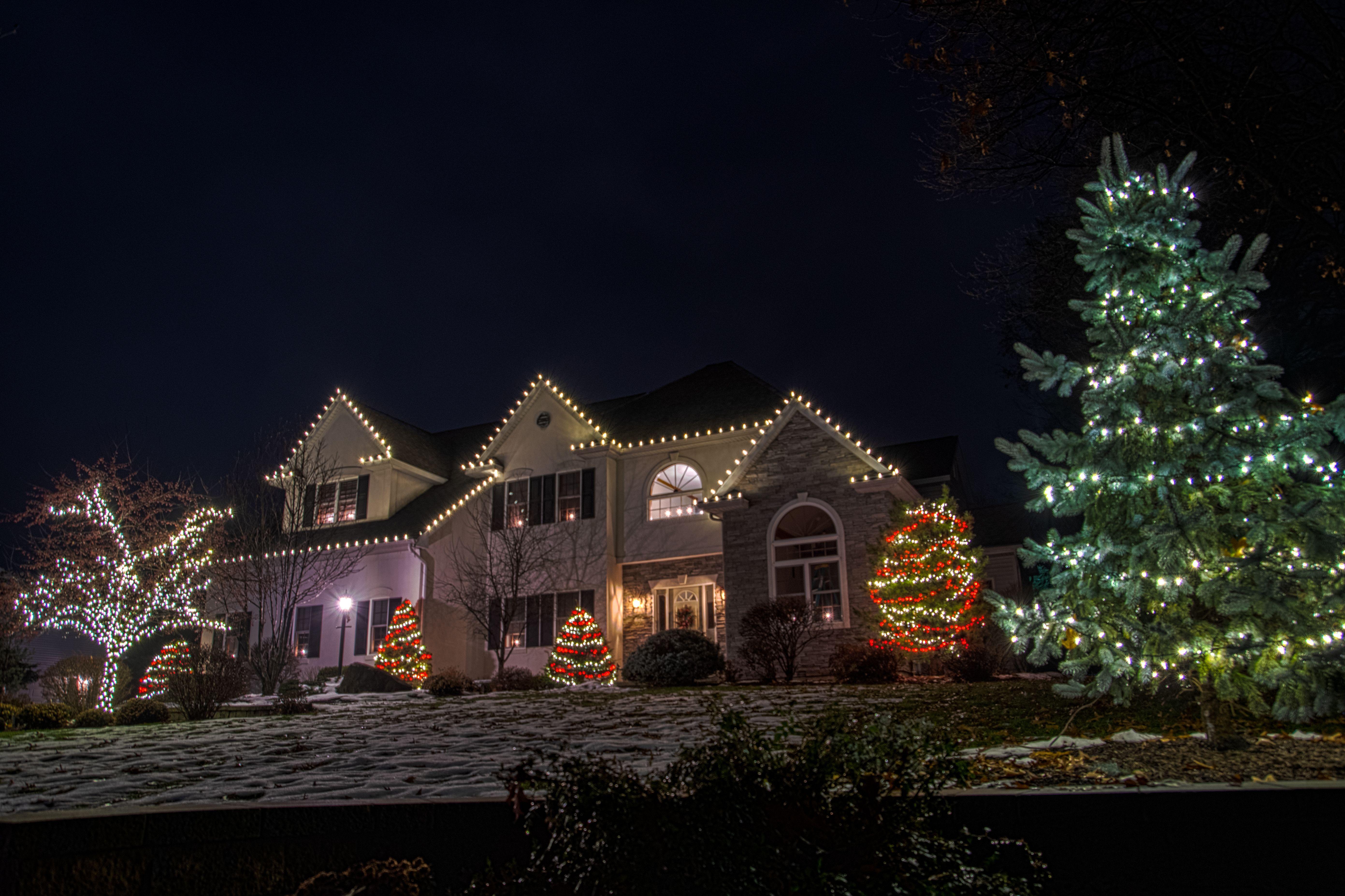 Adding A Splash Color To Your Christmas Decorations Professional Christmas Lights Christmas Light Installation Hanging Christmas Lights