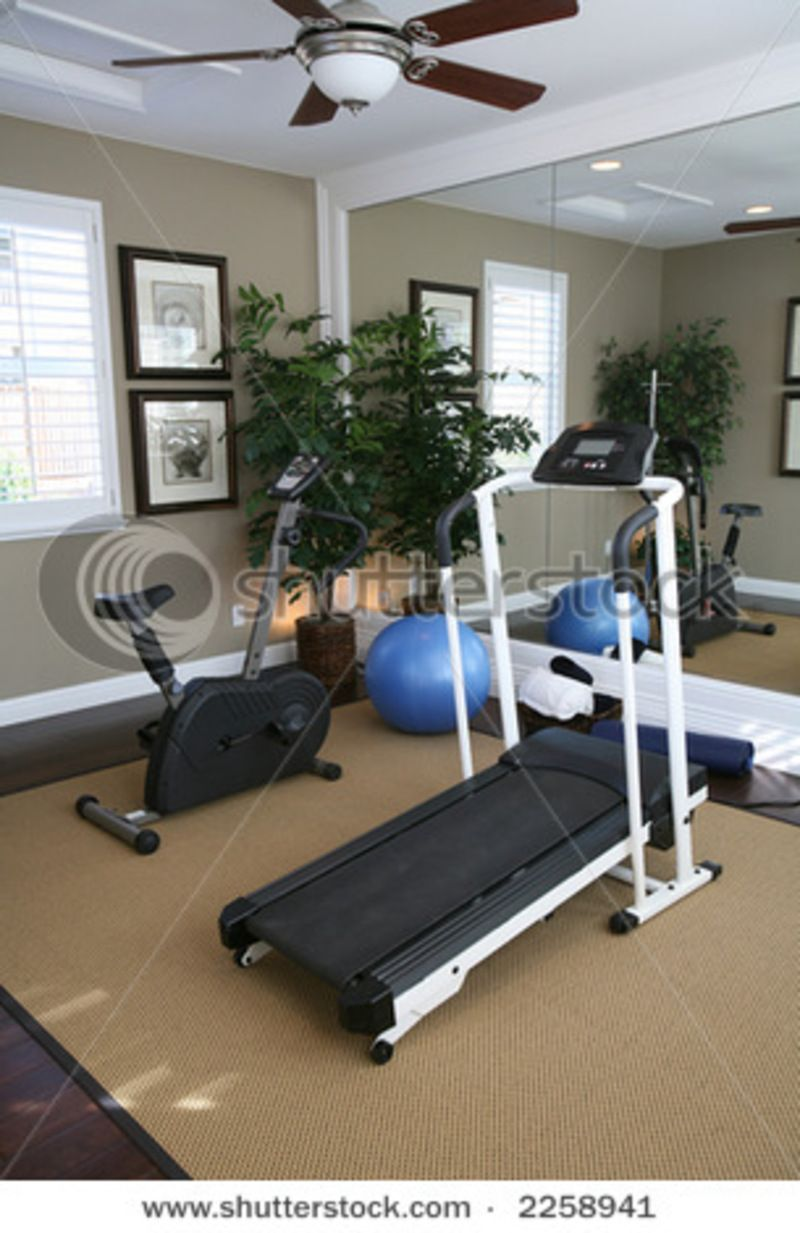 An exercise room inside a residential home stock photo for Small room workout