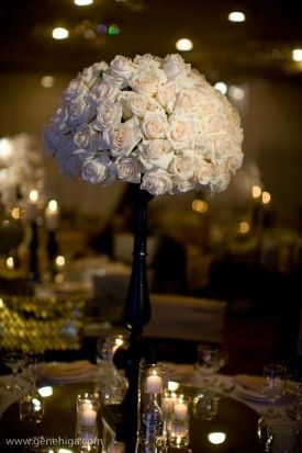 Three Petals Fls With Black Vase Centerpiece