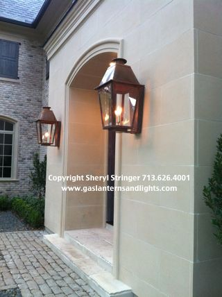 Gas lanterns in entryway and by all french doors back for French doors back porch