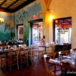 The dining room is quiet at the start of the lunch hour at Via Napoli in Epcot.