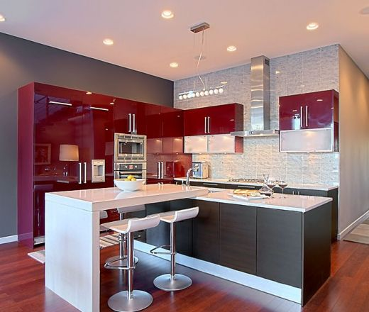 This modern l shaped kitchen features sleek red upper for Grey kitchen cabinets with red walls