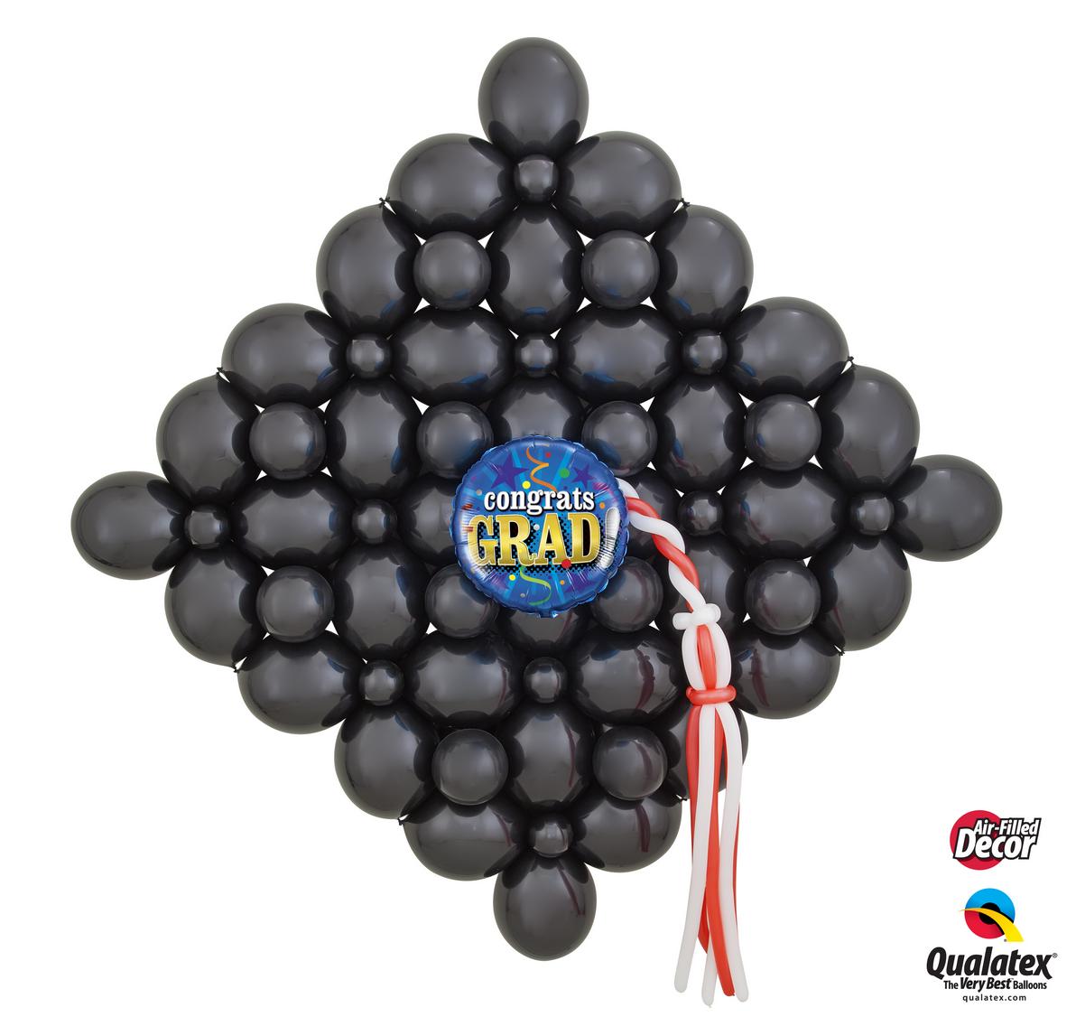 Graduation Hat backdrop balloon wall.
