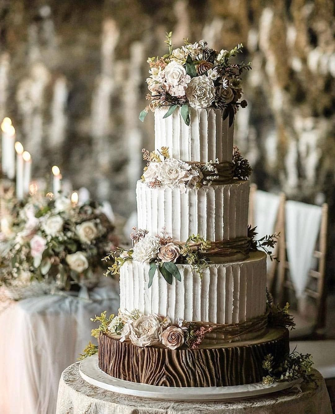 Divine Wedding Flowers: Rustic And Romantic, This Tiered Cake Adorned With Sugar
