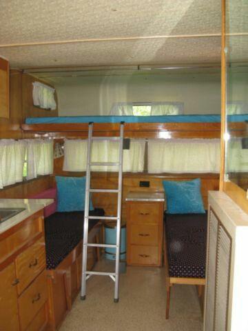 interior 1969 vintage banner camper trailer. beautiful birch. bunk