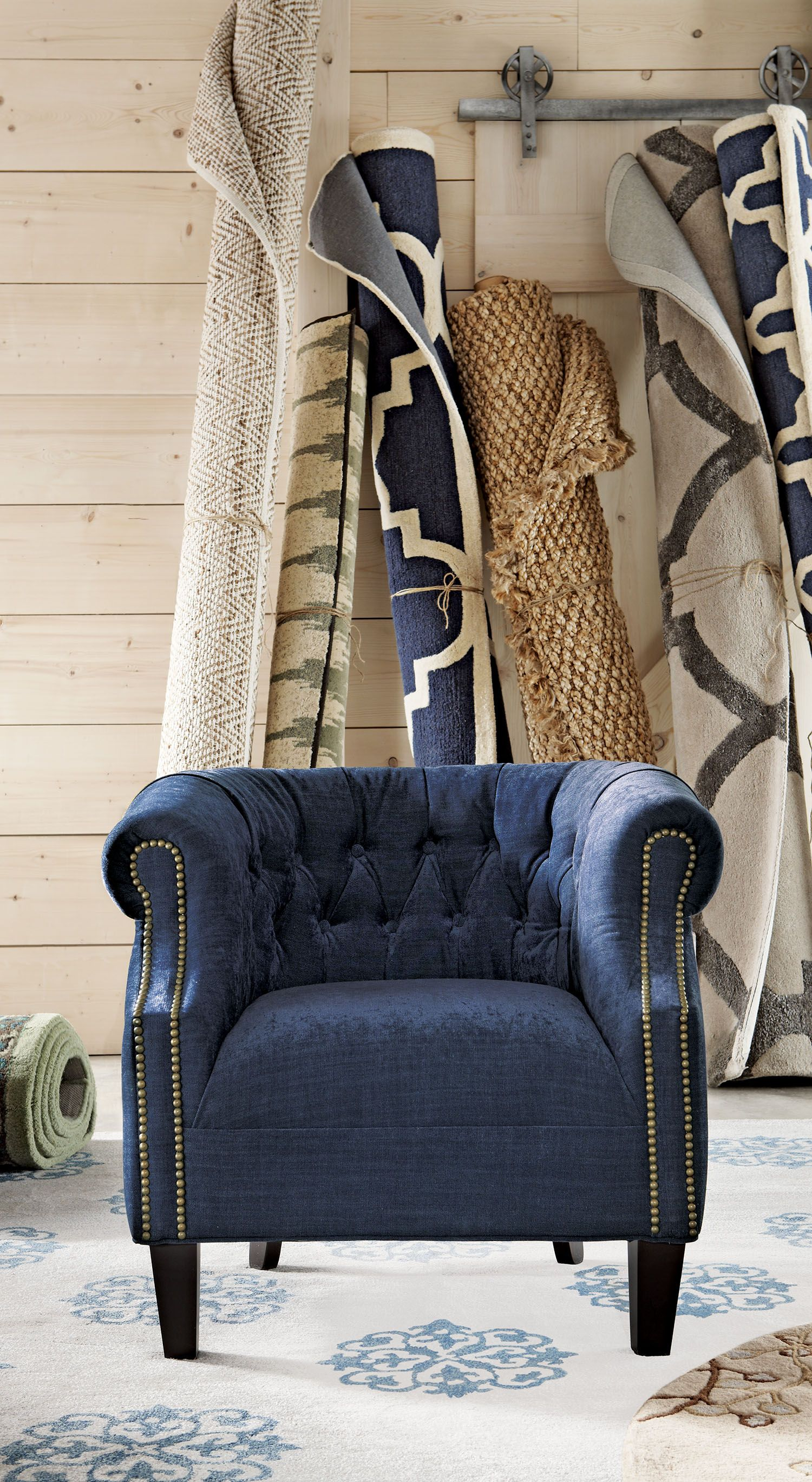 This barrel chair is the perfect accent seat for your living room, bedroom or home office. With 45+ solid and patterned fabric options, you can customize this chair to fit your room's design. How great is that? Plus, choose from different nailhead and leg finishes based on your preference. Style your room the way you like with this custom chair. Available at Home Decorators Collection.