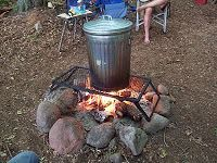 Notes From Camp Freedom: Garbage Can Dinner. We always called this a garbage can cookout.. we always did sweet corn, kielbasa sausage and potatoes. No beer or cabbage.. ick.