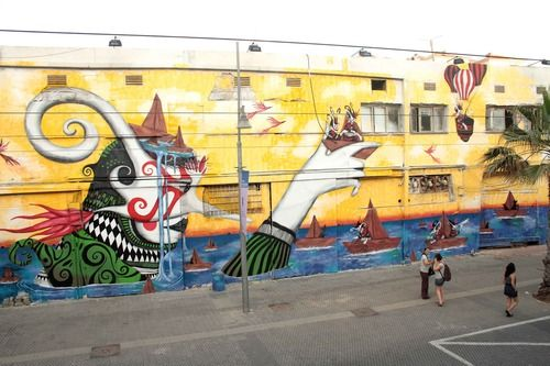 A massive mural by Spain's Skount (now in Amsterdam). Skount's work plays a lot with masks, which both hide and reveal different emotions. He's an interesting cat ...