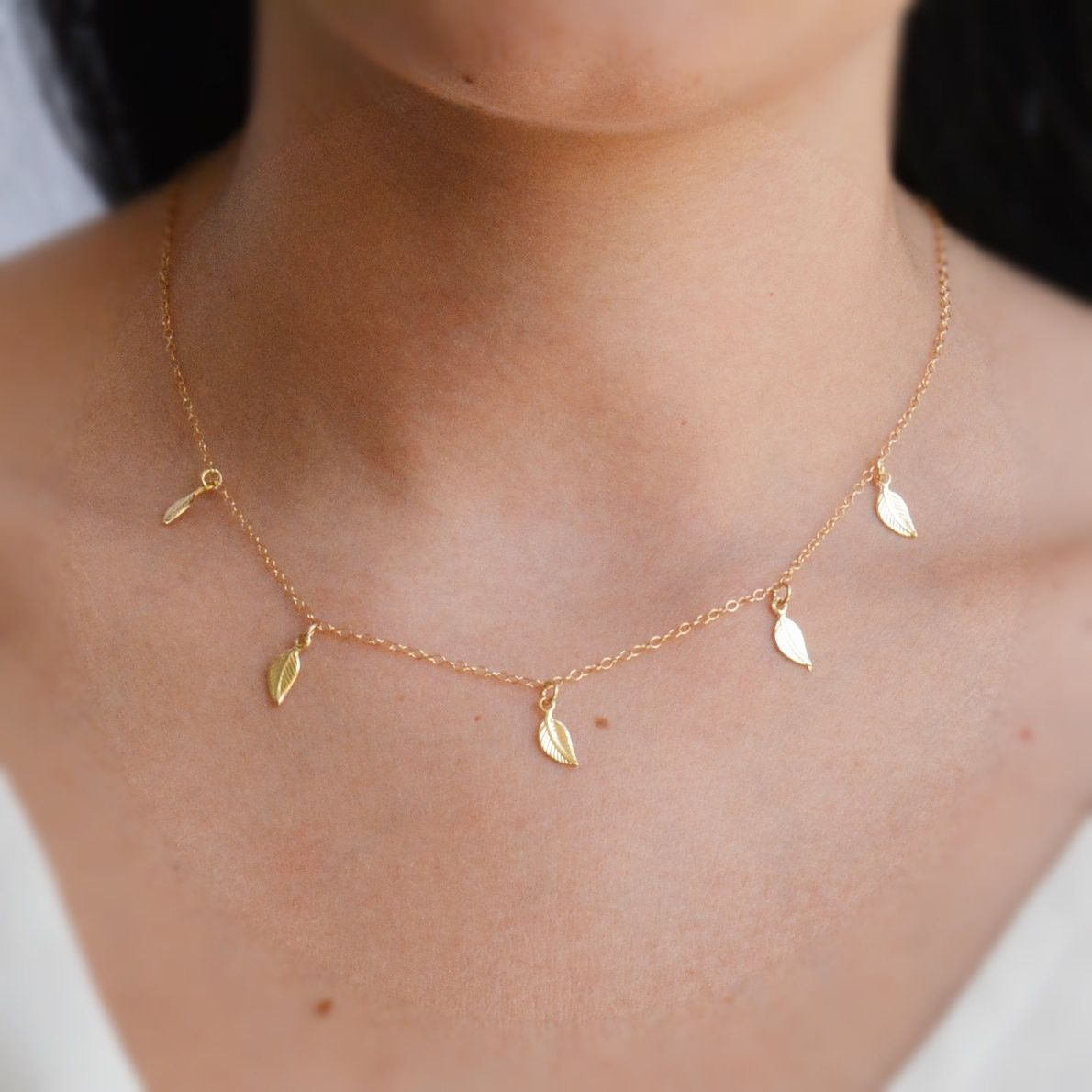 0f2ef368ec leaf necklace,leaf necklace gold,leaf jewelry,gold leaf necklace A  beautiful, unique and delicate necklace. Dainty gold necklace with tiny  leaves hangs on a ...