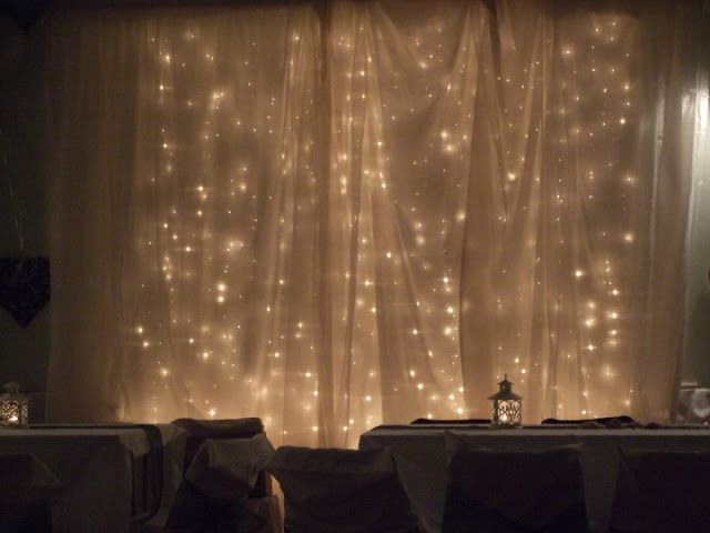These Indoor Ceremony Backdrops Will Make You Pray For: The DIY Wedding Blog- Lights Behind A Cloth Backdrop